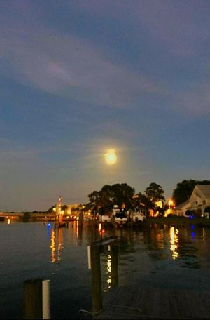Night Photography Water Reflections Skyline Cityscape Water Ripples Lights At Night Boat Dock Moon Over Water Destin,Florida, USA