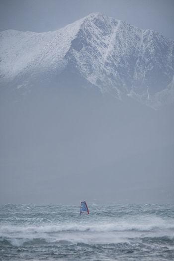 Brave windsurfer under the shadow of mount brandon