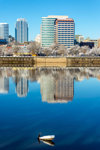 Reflection of buildings against sky on willamette river