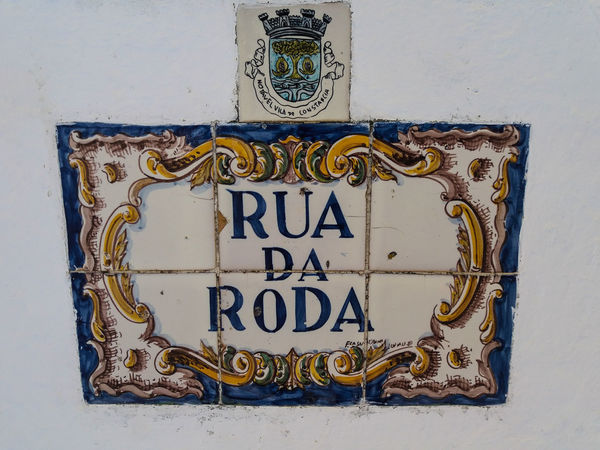 """Portugal EyeEm ZOOM in to see details... Constância, almost all street names in this town are hand painted on """"azulejos"""": https://en.wikipedia.org/wiki/Azulejo. Here are some examples of this beautiful Art... Text Communication Western Script No People Metal Wall - Building Feature Close-up Day Sign Indoors  Number Blue Design Information Rusty Information Sign Old Entrance Gray"""