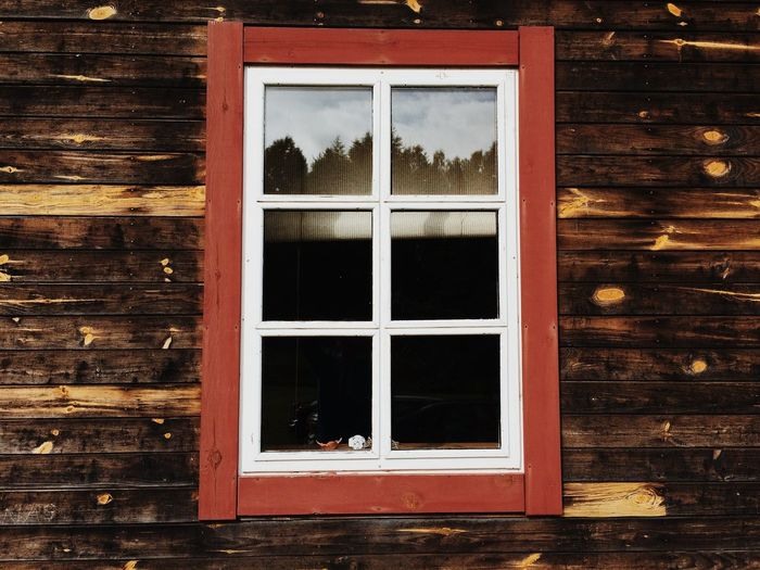 Glass Window On Wooden House
