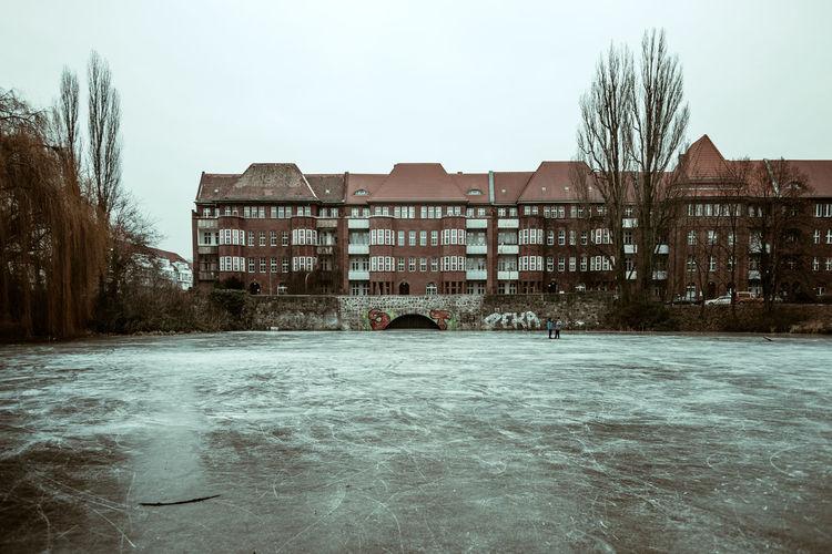 Buildings against clear sky in winter