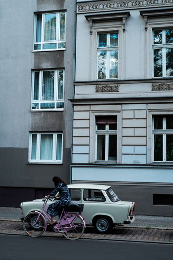 Berlin Woman Architecture Bicycle Building Building Exterior City Germany Mode Of Transportation Motor Vehicle Outdoors Real People Street Summer Transportation Window
