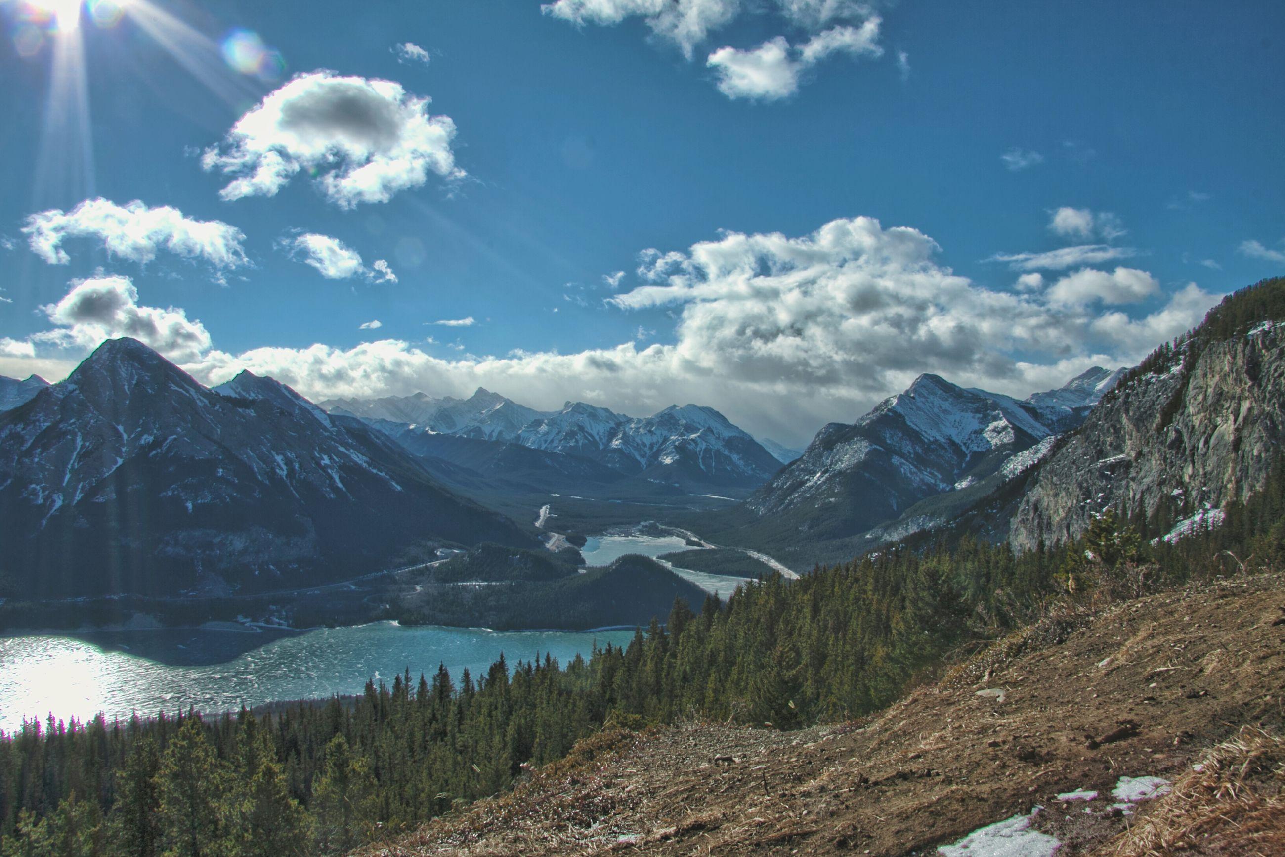 mountain, mountain range, tranquil scene, tranquility, scenics, sky, beauty in nature, water, nature, landscape, lake, sunlight, cloud - sky, idyllic, non-urban scene, cloud, river, blue, sunbeam, outdoors