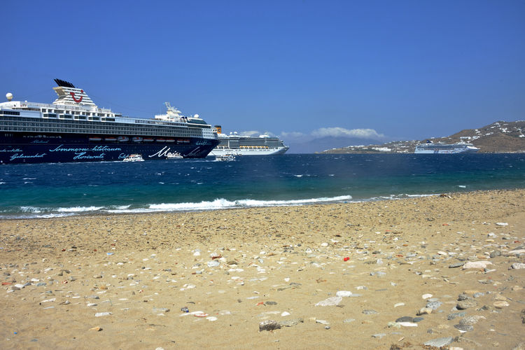 seascape with cruise ships anchored in Mykonos Water Sea Sky Nautical Vessel Transportation Beach Land Nature Mode Of Transportation Ship Architecture Day Motion Built Structure No People Building Exterior Copy Space Outdoors Sand Cruise Ship Passenger Craft Costa Deliziosa TUI-Cruises Mein Shiff Cruise Cruising Seascape Summertime Luxury Lifestyles Mykonos,Greece Sandy Beach Panorama Panoramic View