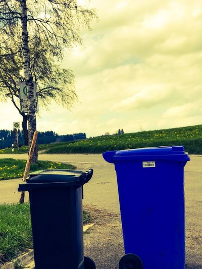 Blue Can Container Day Drum - Container Environment Environmental Conservation Environmental Issues Environmentalist Garbage Garbage Bin Garbage Can No People Outdoors Plastic PLASTIC CONTAINER Pollution Recycling Recycling Bin Responsibility Sky Storage Tank Sustainable Lifestyle Tree Waste Management