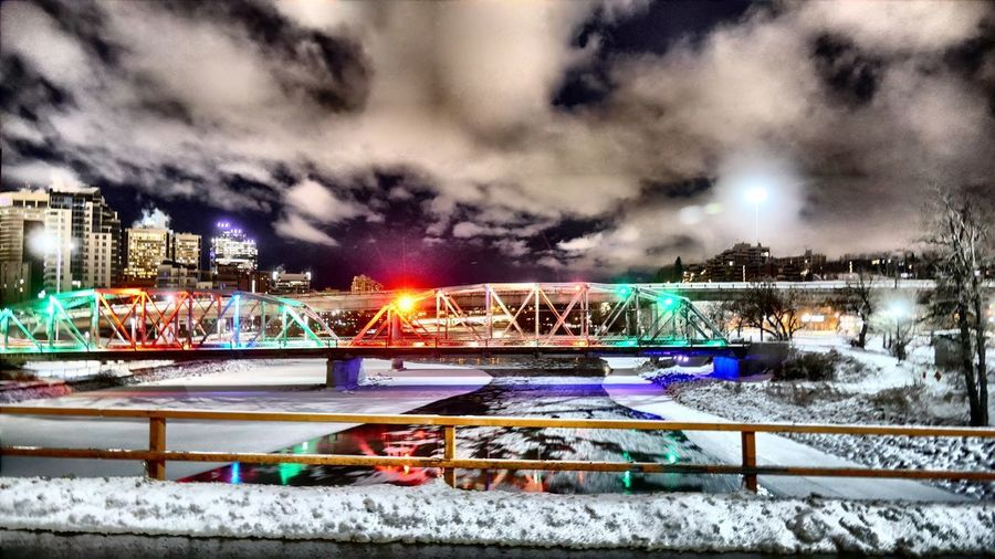 Langevin Bridge from the Flyover. Bridges Reconciliation Bow River Night Illuminated City Long Exposure Sky Architecture Building Exterior Cityscape Outdoors Motion City Life No People Built Structure Multi Colored Cloud - Sky Snow Skyscraper Water