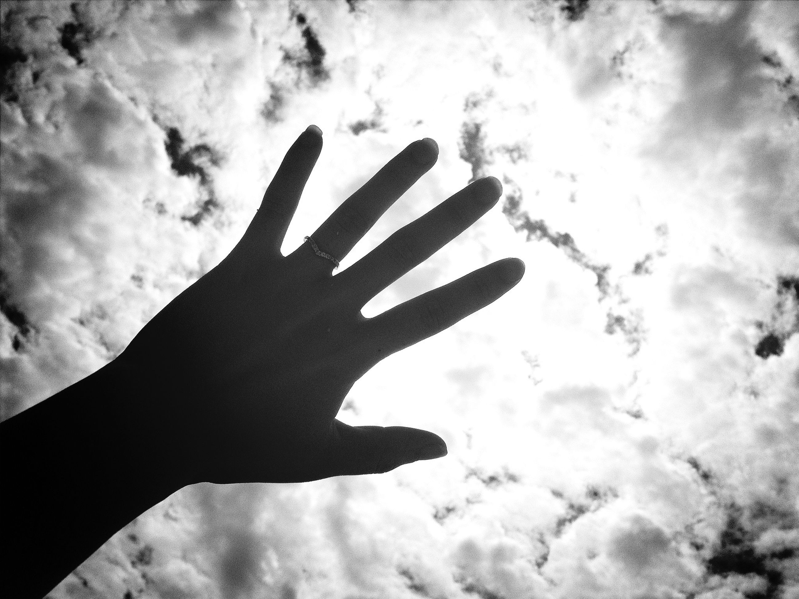 person, part of, human finger, sky, personal perspective, cropped, cloud - sky, lifestyles, holding, unrecognizable person, leisure activity, low angle view, cloudy, cloud, men, silhouette, close-up