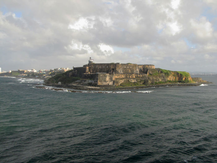 View from the sea of the San Felipe Del Morro Fort in San Juan, Puerto Rico. Fort San Felipe Del Morro Puerto Rico San Felipe San Juan San Juan Island Architecture Beauty In Nature Building Building Exterior Built Structure Cloud - Sky Day History Land Nature No People Outdoors San Juan Islands San Felipe Del Morro Scenics - Nature Sea Sky Travel Water Waterfront