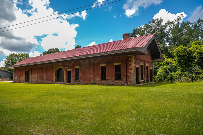 Old Hancock County Railroad Depot Architecture Building Building Exterior Built Structure Cloud - Sky Day Environment Field Grass Green Color Growth House Land Landscape Nature No People Outdoors Plant Sky Tree