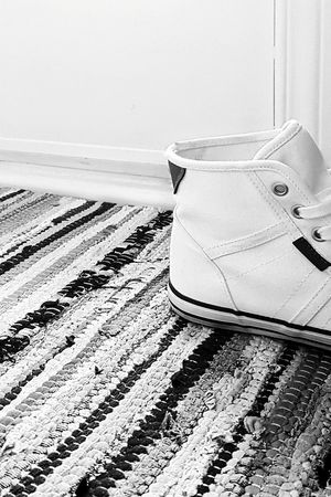 There are always shoes at the door... Quickgetaway Trainers Hightops Sneakers Footwear Shoe Bnw Black And White Mobile Photography Eye4photography  EyeEm Gallery Floortrait Striped   Beach Sand No People Day Outdoors   Out Of The Box Black And White Friday The Fashion Photographer - 2018 EyeEm Awards The Still Life Photographer - 2018 EyeEm Awards
