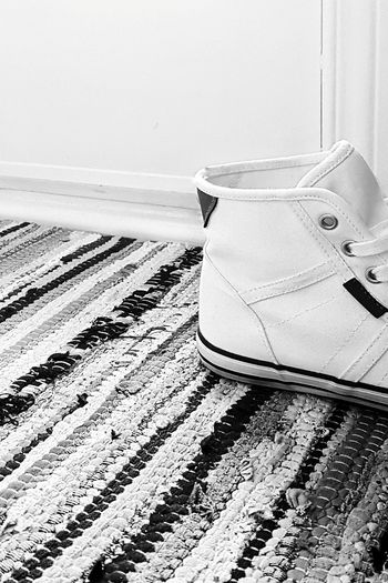There are always shoes at the door... Quickgetaway Trainers Hightops Sneakers Footwear Shoe Bnw Black And White Mobile Photography Eye4photography  EyeEm Gallery Floortrait Striped | Beach Sand No People Day Outdoors | Out Of The Box Black And White Friday The Fashion Photographer - 2018 EyeEm Awards The Still Life Photographer - 2018 EyeEm Awards
