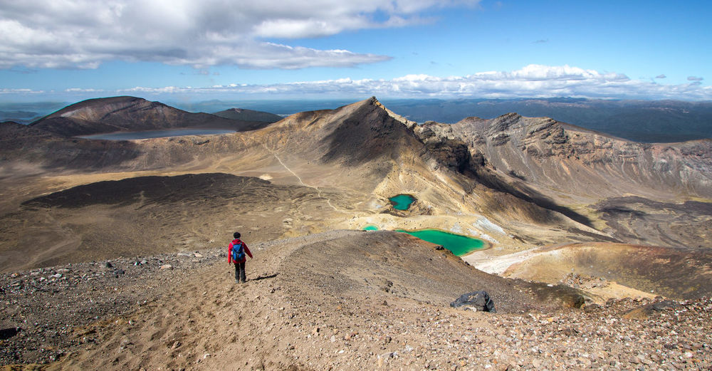 Rear view of person hiking at tongariro alpine crossing