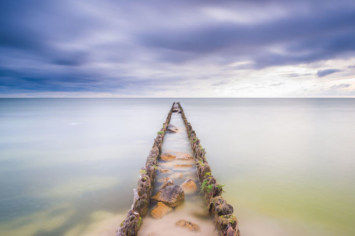Breakwater in Lake IJsselmeer EyeEmNewHere The Netherlands Beauty In Nature Breakwater Close-up Cloud - Sky Day Horizon Over Water Ijsselmeer Landscape Longexposure Nature No People Outdoors Scenics Sea Seascape Sky Stones Sunset Tranquil Scene Tranquility Water