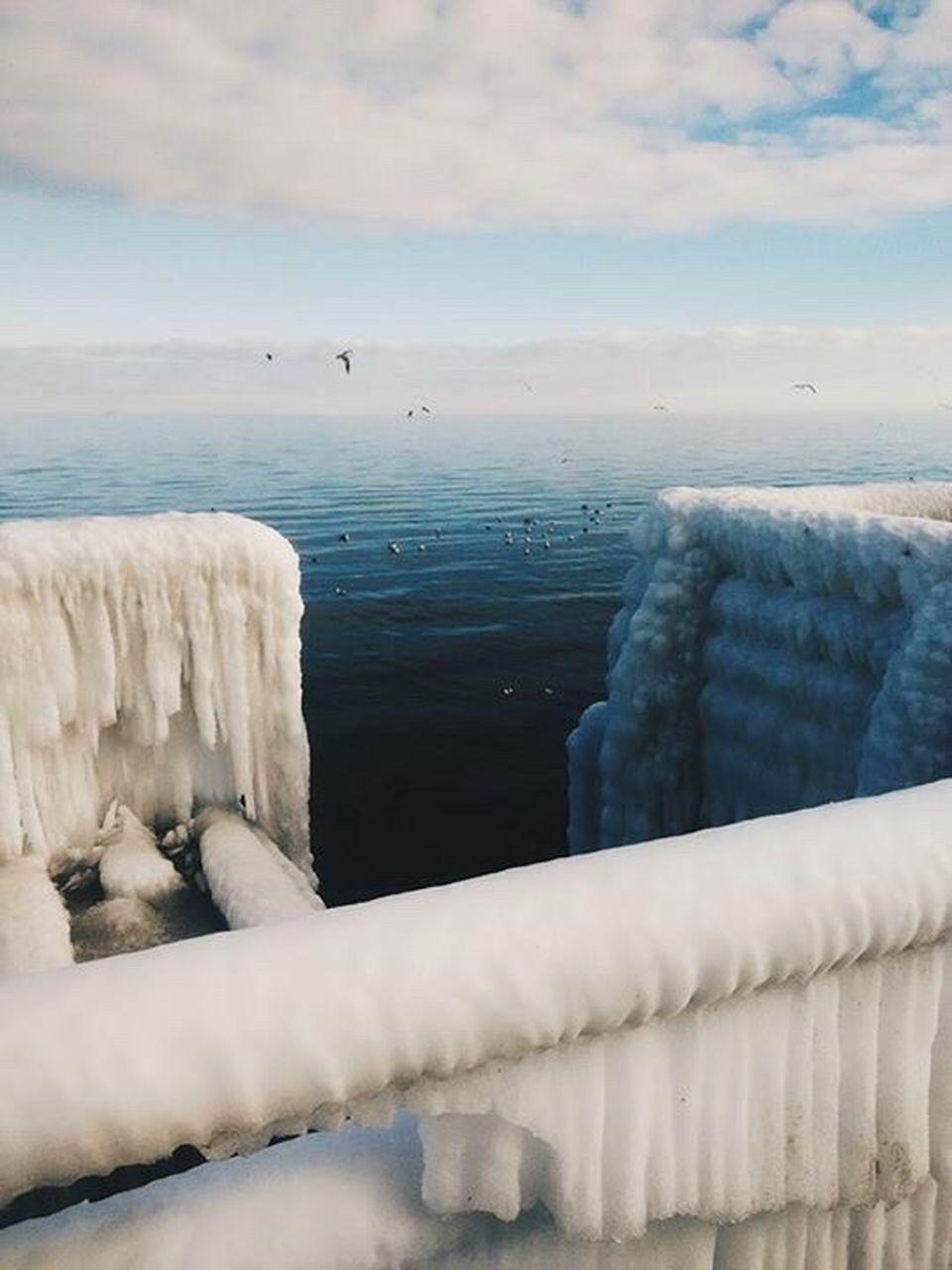 SNOW ON SEA AGAINST SKY