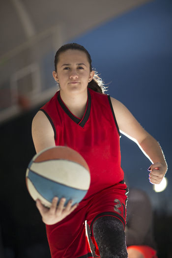 Portrait Of Woman Holding Basketball Ball