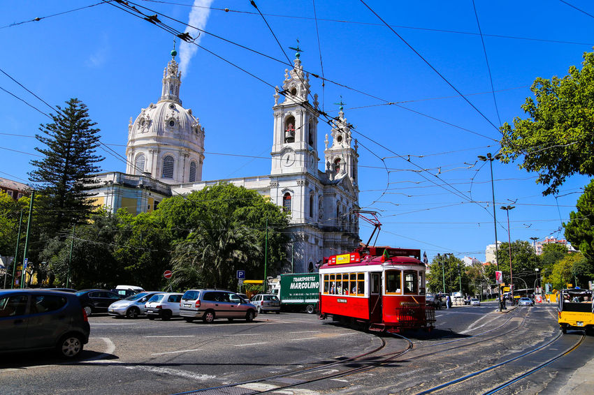 Architecture Building Exterior Built Structure Church City Clock Tower Colorful Composition Cross History Lisbon Outdoors Overhead View Perspective Place Of Worship Portugal Religion Spirituality Street Sun Top Perspective Tram Travel