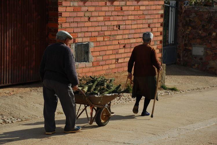 Full Length Of Senior Couple On Street