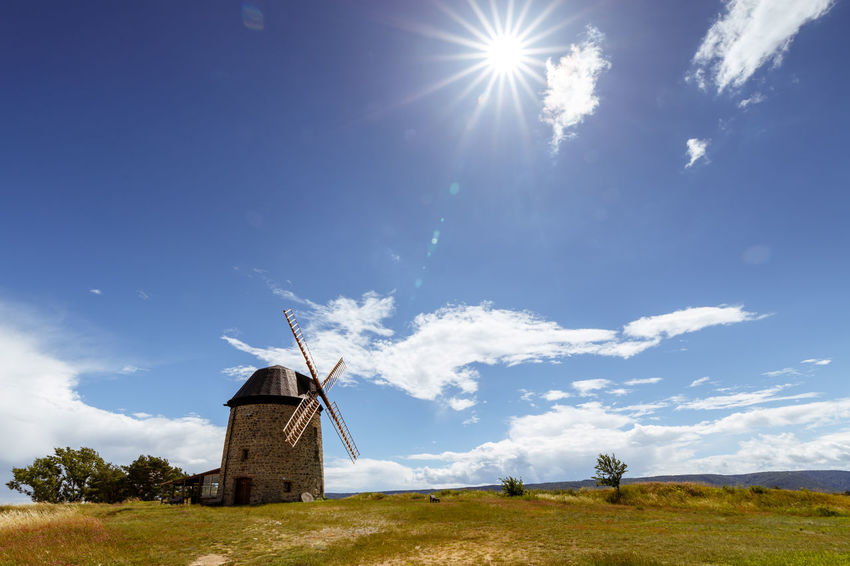 Teufelsmühle Alternative Energy Beauty In Nature Bright Built Structure Cloud - Sky Day Environment Field Fuel And Power Generation Grass Harz Harzmountains Land Landscape Lens Flare Nature No People Outdoors Sky Sun Sunbeam Sunlight Turbine Wind Power Wind Turbine