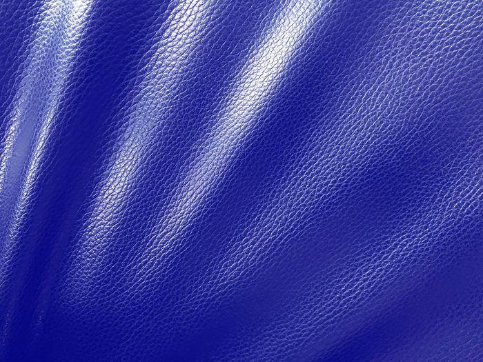 Full frame shot of blue leather sofa