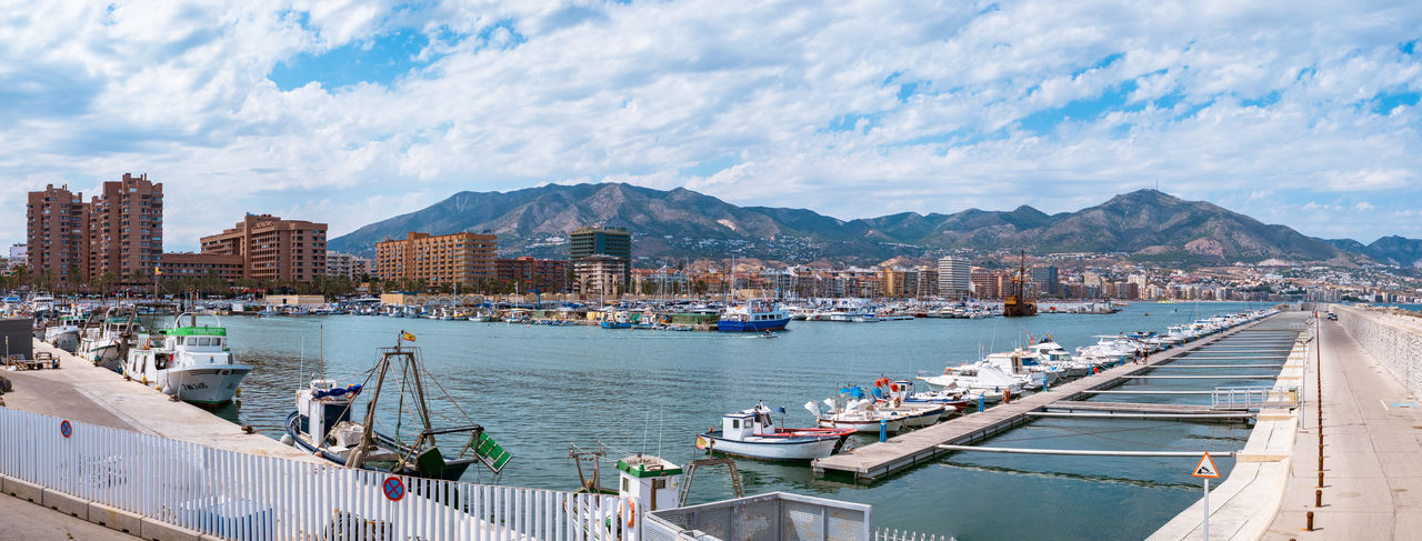 Fuengirola city and port bay panorama, Spain Fuengirola City And Port Bay Panorama SPAIN Fuengirola Spain Bay Boats Water Mountain Architecture Nautical Vessel Cloud - Sky Sky Transportation Building Exterior Built Structure Mode Of Transportation City Harbor Moored Mountain Range Nature Sea Day Travel No People Outdoors Sailboat Yacht My Best Photo