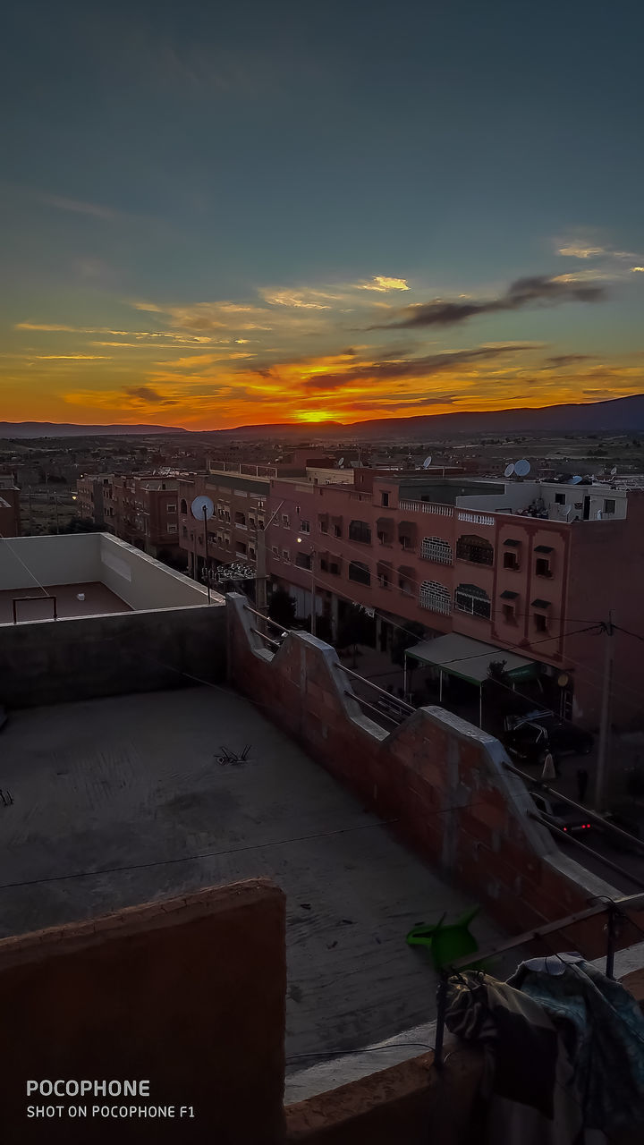 HIGH ANGLE VIEW OF BUILDINGS DURING SUNSET