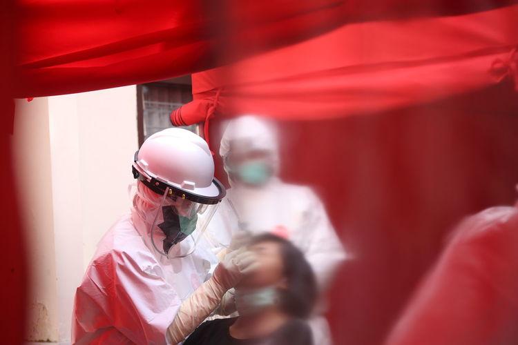 Close-up of doctors examining patient