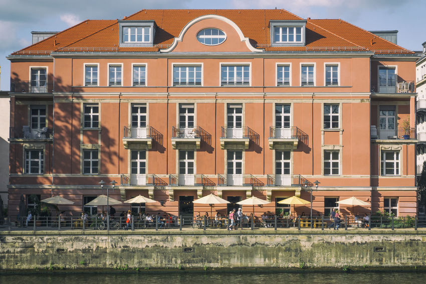 Old building at Spree River with outdoor cafe Berlin Façade Germany 🇩🇪 Deutschland Al Fresco Architecture Building Exterior Built Structure City Color Image Day No People Outdoors Residential Building Sky Sunshades Water Window