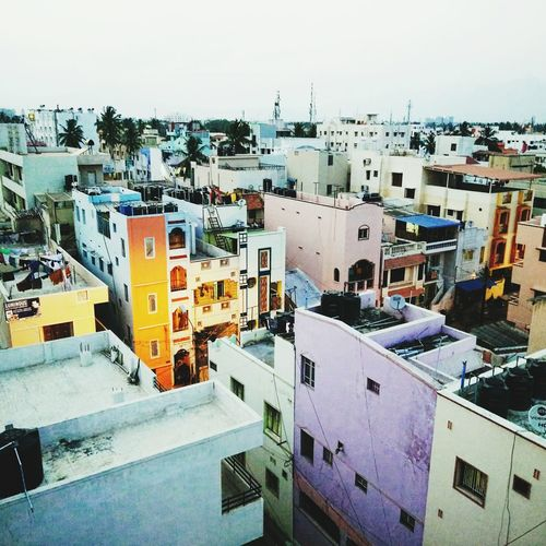 India from the roof Cityscape Roof Travel Destinations Residential Building Architecture Outdoors Built Structure Building Exterior Day Indoors  Cityscape First Eyeem Photo Architecture Indoors  City House Crowded Sky Building Terrace People