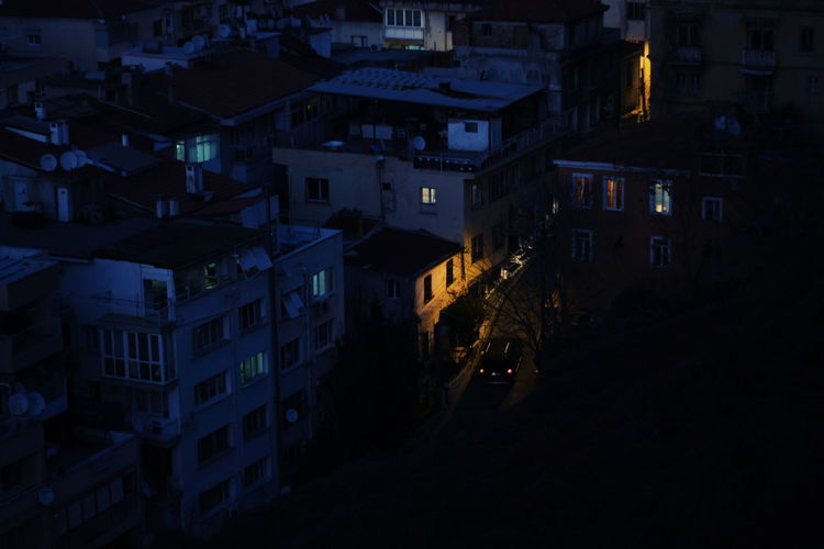 High angle view of illuminated buildings at night