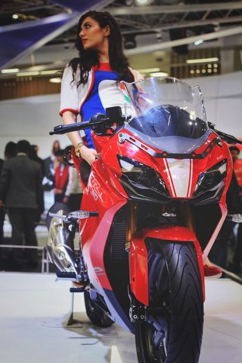 apache rr310 Like Auto Post Production Filter Automobile Photography Speed Superbike Sport Bikes Casual Clothing Full Length Standing Leisure Activity Young Adult Front View Indoors  Young Women Clothing Land Vehicle Beautiful Woman Motorcycle Travel