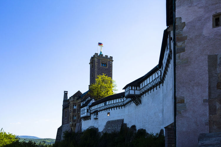 Architecture Blue Building Building Exterior Built Structure Castle City City Life Clear Sky Day Eisenach Low Angle View Martin Luther Modern Nature No People Outdoors Sky Tall - High Thuringia Travel Destinations Wartburg
