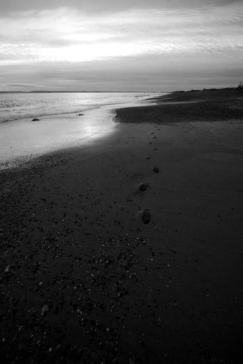 Footsteps Beach Beauty In Nature Black And White Blackandwhite Cloud - Sky Footsteps Horizon Horizon Over Water Idyllic Landscape Sand Scenics - Nature Sea Sky Tranquil Scene Tranquility Water