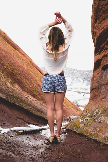 Rock Formations Limb Arms Raised Only Women Human Arm Young Adult One Person Human Body Part People Adult Front View Long Hair Rock - Object Full Length Leisure Activity Nature Vacations Day One Woman Only One Young Woman Only Outdoors