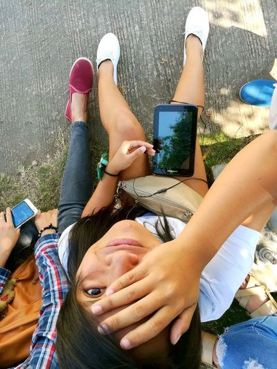 different perspectives.. Wireless Technology Technology Only Women High Angle View Young Adult Smart Phone Human Leg Low Section Dual Camera Sunnyday Phone Photography Eyeem Philippines Huaweigr52017 Bicol EyeEm Gallery EyeEm Best Shots Philippines Relaxation Portable Information Device Friendship People Leisure Activity Young Women Communication Lifestyles
