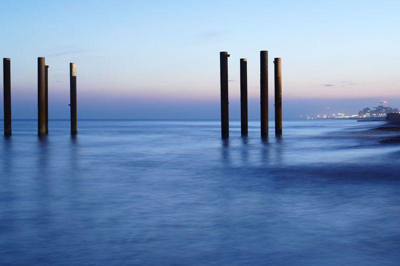 Sea Sky Post Tranquil Scene Sunset Tranquility Scenics - Nature
