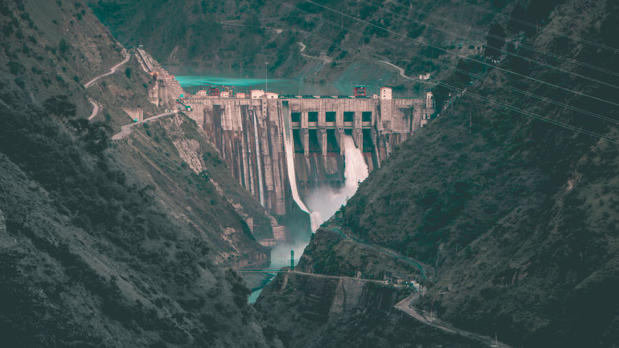 High angle view of dam by mountains