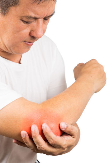Asian man with painful inflamed pain on the elbow because of gout Asian  Gout Healthcare Pain Casual Clothing Close-up Elbow Inflammation Mature Adult Mature Men Men One Person Real People Red Color Studio Shot White Background