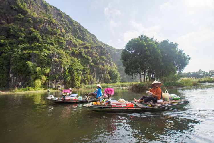 Tam Coc, Vietnam Nautical Vessel Water Transportation Group Of People Leisure Activity Tree Real People Day Women Waterfront Mode Of Transportation Lifestyles Plant River Nature Adult Sitting People Outdoors Tam Coc Vietnam Travel