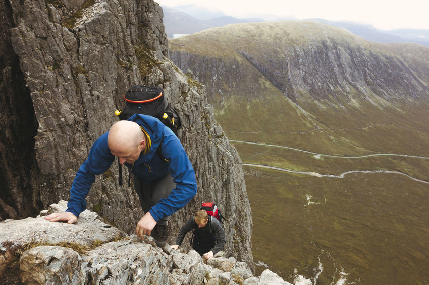 Curved Ridge Glencoe Hiking Scotland Scrambling Vacations Active Lifestyle  Activity Adventure Beauty In Nature Climbing Extreme Sports Fitness Leisure Activity Lifestyles Men Mountain Nature Outdoors Real People Rock Climbing Scottish Highlands Togetherness Travel Destinations Two People