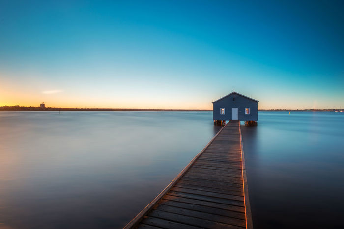 Long Exposed sunrise at Crawley Edge Boat Shed Architecture Australia Australian Landscape Blue Shed Boat Shed Calm Clear Sky Crawley Edge Horizon Over Water Landscape Leading Lines Long Exposure No People Outdoors Perth Pier River Scenics Sea Shed Sky Sunset Swan River Travel Water