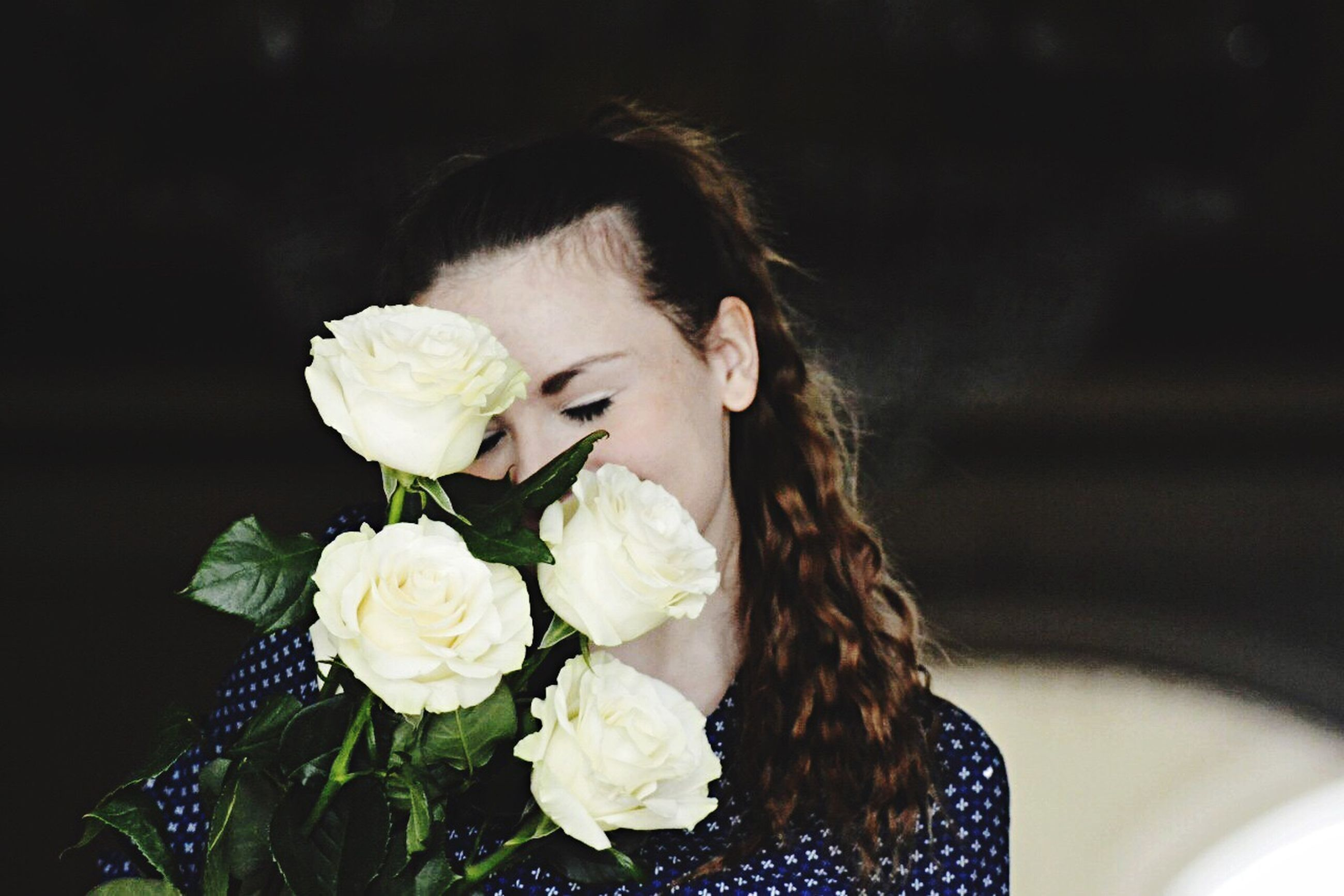 flower, freshness, fragility, petal, flower head, focus on foreground, holding, indoors, lifestyles, close-up, white color, rose - flower, leisure activity, bunch of flowers, bouquet, blooming, casual clothing, nature