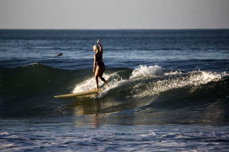 Sea Water Sport Horizon Horizon Over Water Motion Leisure Activity Sky Aquatic Sport Surfing Beauty In Nature Lifestyles One Person Nature Waterfront Wave Day Real People Outdoors