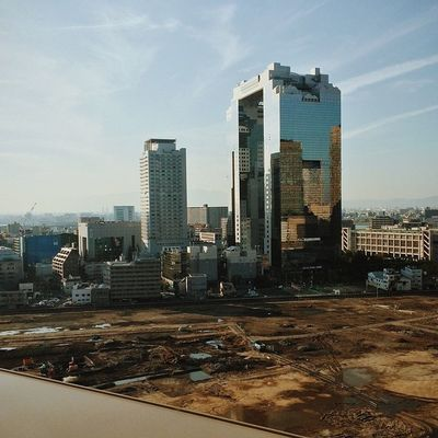 View from the Osaka Station City - the Umeda Sky Building. You can't truly tell from that angle but there is a giant hole in it. OSAKA Candjsbigtrip2014 Vscocam VSCO Architecture