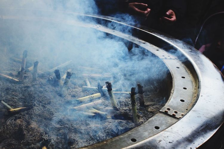 High Angle View Of Smoke Emitting From Incense At Temple
