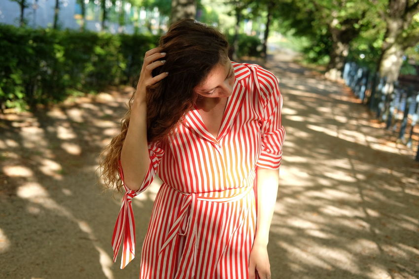 summer stroll model Julia Bond Beautiful Woman Casual Clothing Day Focus On Foreground Hair Hairstyle Lifestyles Long Hair Nature Obscured Face One Person Outdoors Real People Standing Striped Sunlight Three Quarter Length Tree Waist Up Young Adult Young Women
