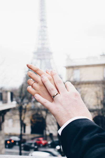 Just Married Couple Eiffel Tower Just Married Marraige Married Wedding Wedding Photography Architecture Building Exterior Built Structure City Close-up Day Eiffel Elopement Focus On Foreground Human Body Part Human Hand Men One Person Outdoors People Real People Sky Wedding Ring