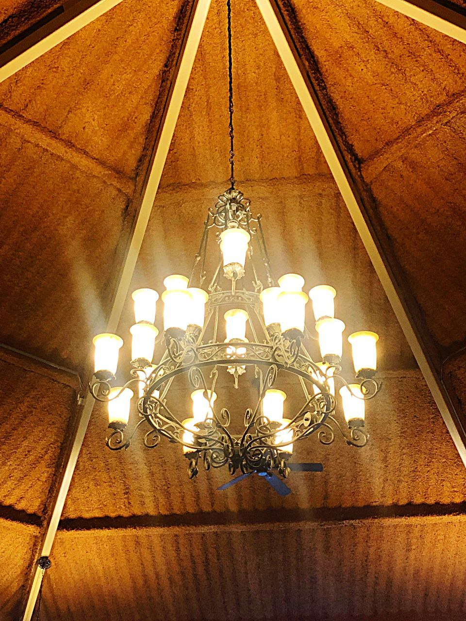 lighting equipment, illuminated, ceiling, indoors, chandelier, low angle view, hanging, architecture, electricity, light, no people, built structure, decoration, pendant light, glowing, electric light, luxury, light - natural phenomenon, wealth, home interior, electric lamp, ornate, directly below, light fixture, glass