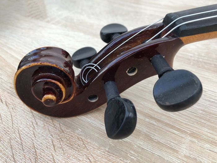 Close-up of violin on floor