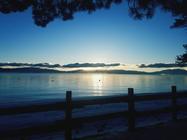 Lake Tahoe sunrise. #sunrise #reflection #sunset #sun #clouds #skylovers #skyporn #sky #beautiful #sunset #clouds And Sky #beach #sun _collection #sunst And Clouds Silhouette Tranquility Nature Sky Beach